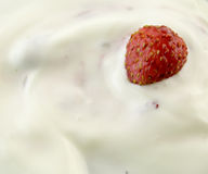 Strawberry with cream. Tasty yoghurt royalty free stock photography
