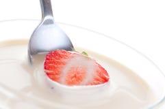 Strawberry in cream. Royalty Free Stock Photo