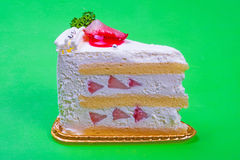 Strawberry cream cake in green background Stock Images