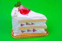 Strawberry cream cake in green background Royalty Free Stock Photography
