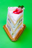 Strawberry cream cake in green background Royalty Free Stock Images