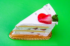 Strawberry cream cake in green background Royalty Free Stock Photos