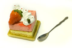 Strawberry cream Cake. With spoon in pure white background Stock Images