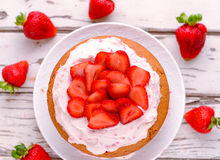 Strawberry cream cake. Summer fruit cake with berries and whipped cream royalty free stock photos