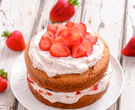 Strawberry cream cake. Summer fruit cake with berries and whipped cream royalty free stock photo