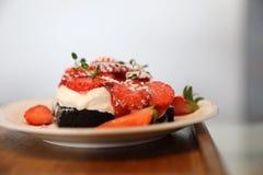 Strawberry cream cake on wooden tray