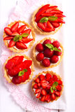 Strawberry and cream cheese mini cakes on table Stock Photos