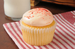 Strawberry cream cupcake with milk Stock Images