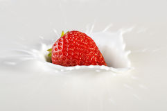 Strawberry in a cream. Royalty Free Stock Image