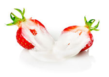Strawberry with cream isolated on the white background Stock Photography