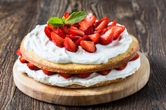 Strawberry cream layer cake. Homemade cream layer cake, fresh, colorful, and delicious dessert with juicy strawberries, and sweet whipped cream stock photo