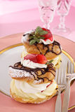 Strawberry cream puffs Stock Photos