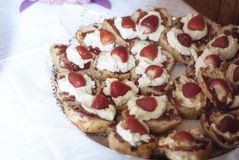 Strawberry cream scones. Scones with strawberries and cream, ready for a party or celebration Royalty Free Stock Images
