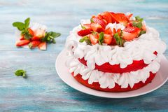 Strawberry and cream sponge cake. Homemade summer dessert on blue wooden table. Sweets for loved ones Stock Image