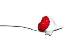 Strawberry and cream on spoon Royalty Free Stock Photos