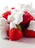 Strawberry with cream on white reflexive background Stock Images