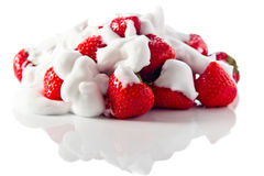 Strawberry with cream on white reflexive background Royalty Free Stock Photography