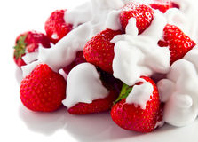 Strawberry with cream on white reflexive background. Strawberry  with cream isolated on white reflexive background Stock Photos