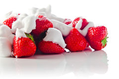 Strawberry with cream on white reflexive background Stock Photography