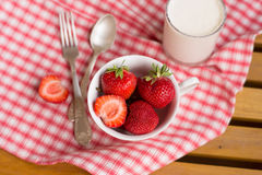 Strawberry with creams, spoons, breakfast Royalty Free Stock Photography
