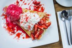 Strawberry crepe banana dessert. Ice cream dessert Stock Images