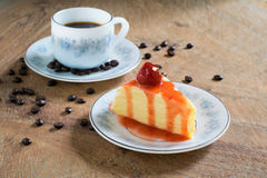 Strawberry crepe cake and a cup of coffee Stock Image