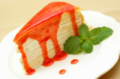 Strawberry crepe cake on white dish. Juicy Strawberry crepe cake on white dish Royalty Free Stock Photo
