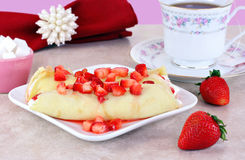 Strawberry Crepes in a feminine table setting. Royalty Free Stock Images