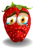 Strawberry with crying face Stock Images