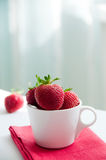 Strawberry in cup Stock Images