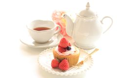 Strawberry cup cake and English tea. Tea pot and flower on background for tea time image Royalty Free Stock Images