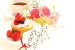 Strawberry cup cake and hand written card. With English tea and  flower Royalty Free Stock Photo