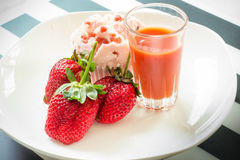 Strawberry cup cake and juice. On a white plate Stock Photo