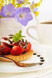 Strawberry with cup of coffee, summer flowers Royalty Free Stock Photos