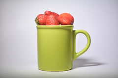 Strawberry. Cup forest goodies on white background Royalty Free Stock Image
