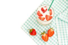 Strawberry and cup of milk Royalty Free Stock Images