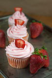 Strawberry Cupcaakes. Strawberry cupcakes with fresh strawberries  on a table top Royalty Free Stock Photos