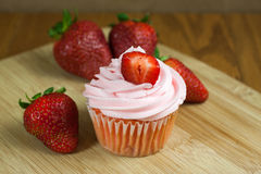 Strawberry Cupcaakes. Strawberry cupcakes with fresh strawberries  on a table top Stock Photos