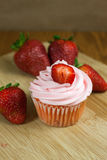 Strawberry Cupcaakes. Strawberry cupcakes with fresh strawberries  on a table top Stock Photo