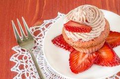 Strawberry cupcake with butter cream decorated with slices of fresh strawberries Stock Photography