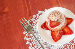 Strawberry cupcake with butter cream decorated with slices of fresh strawberries Royalty Free Stock Photo