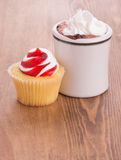 Strawberry cupcake with a cup of hot chocolate Royalty Free Stock Images