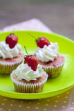 Strawberry cupcake on a green dish. Strawberry cupcake with Strawberry on a green dish Stock Photos