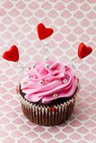 Strawberry cupcake with heart shapes and metal beads Stock Photos