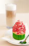 Strawberry cupcake on a table Stock Photos