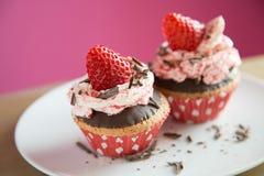 Strawberry cupcakes with chocolate Stock Photos
