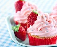 Strawberry cupcakes with sprinkles Stock Photos