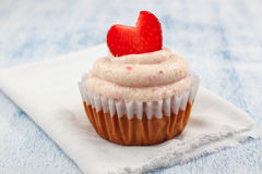 Strawberry Cupcakes with strawberry frosting and fresh Strawberry Hearts Stock Photo