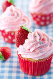 Strawberry cupcakes on vintage blue towel Royalty Free Stock Photo