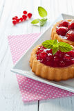 Strawberry and currant tarts. On a plate Royalty Free Stock Photography